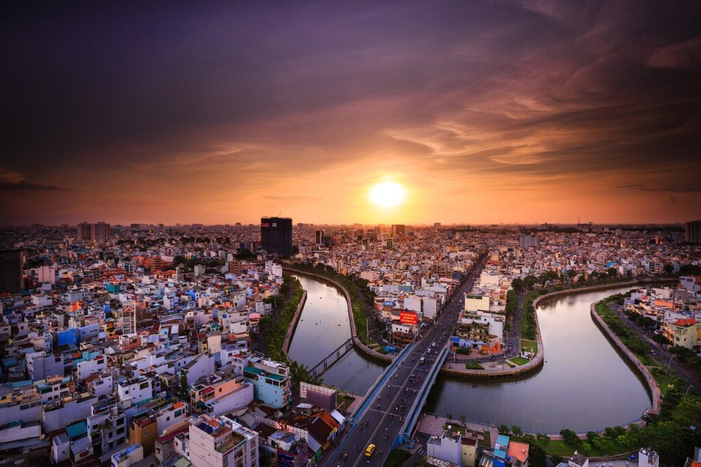 Aerial Shot at Dusk of Ho Chi Minh City. Asian River cruising on Mekong