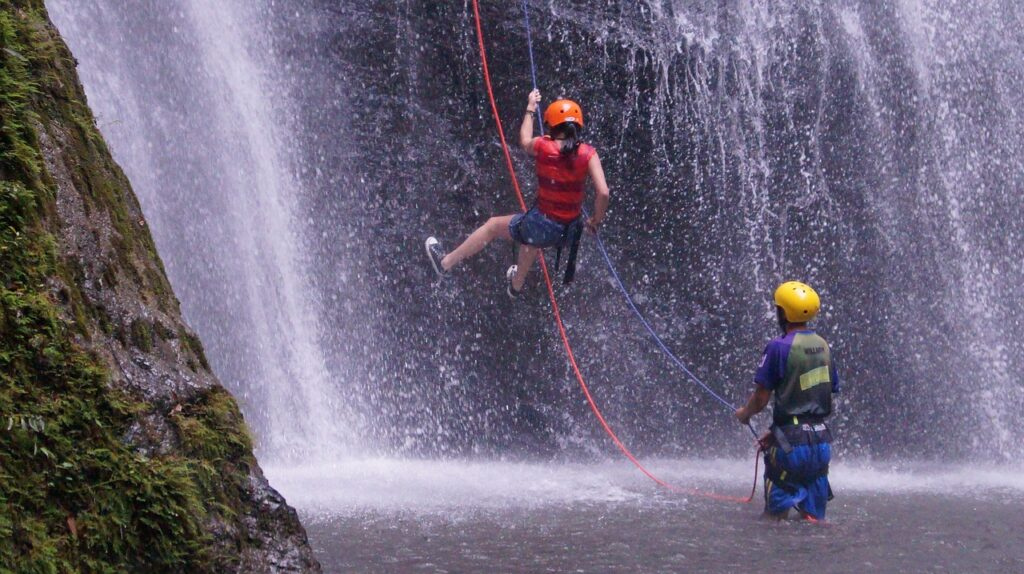 Girl Abseiling Waterfall